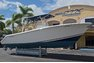 Thumbnail 1 for Used 2013 Cobia 296 Center Console boat for sale in West Palm Beach, FL