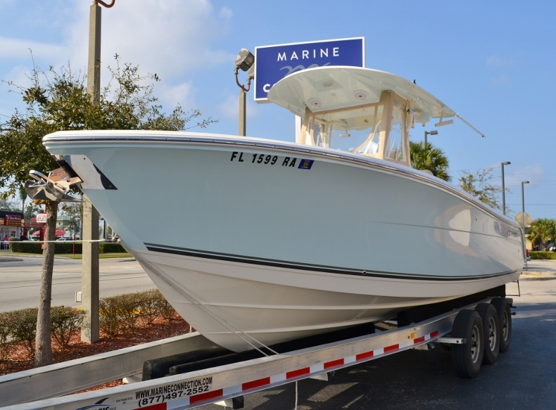 Thumbnail 1 for Used 2016 Cobia 277 Center Console boat for sale in Vero Beach, FL