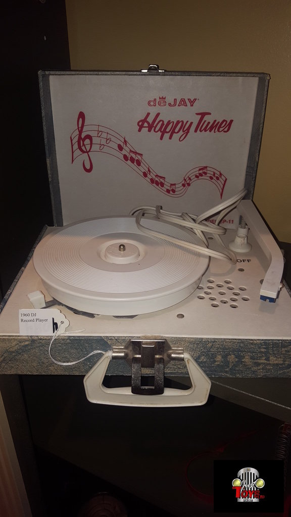 1960 DeJay Happy Tunes Record Player.