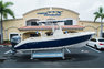 Thumbnail 1 for Used 2014 Cobia 256 Center Console boat for sale in Vero Beach, FL