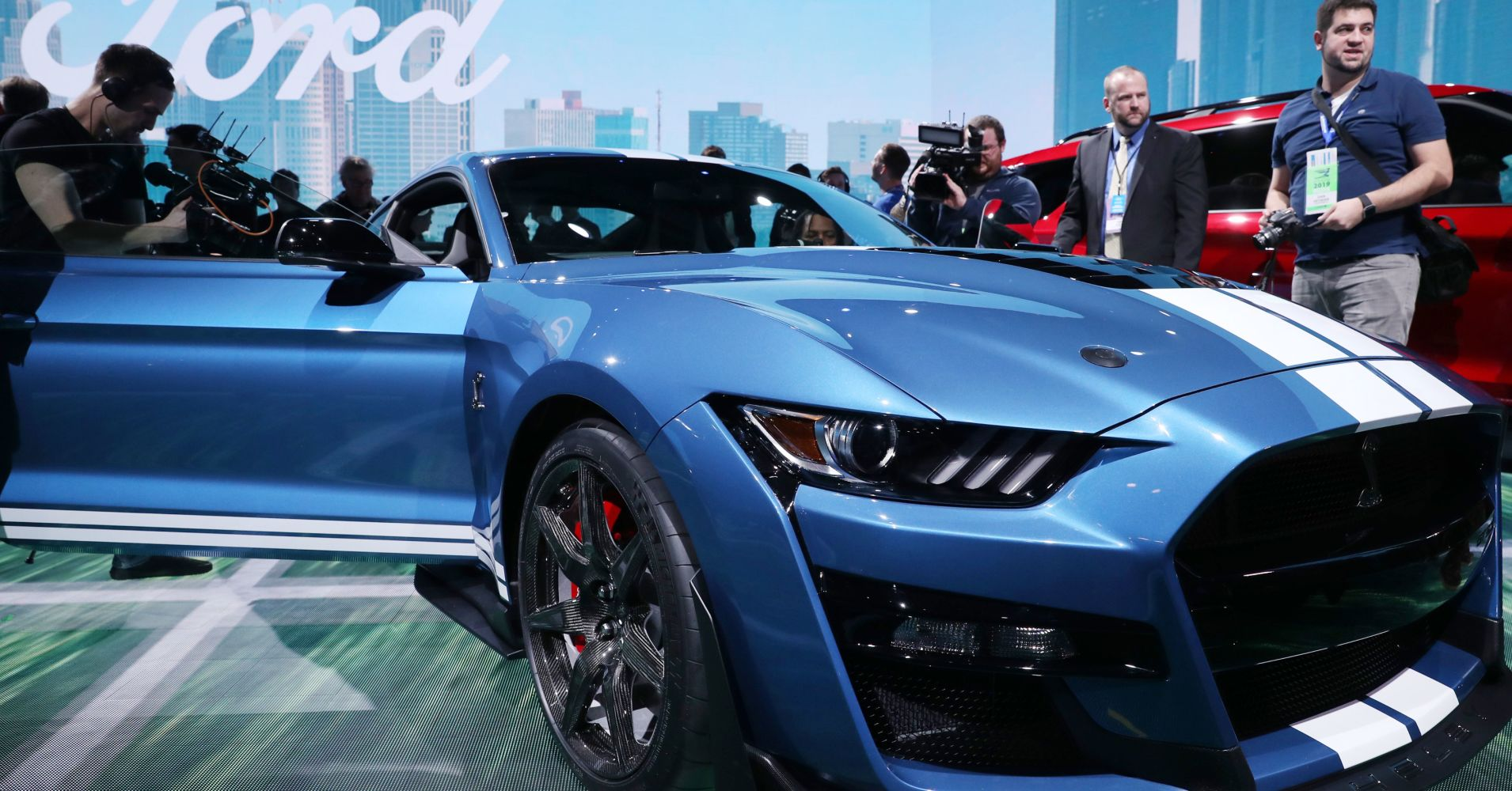 Jonathan Ernst | Reuters Members of the media look over the 2020 Ford Mustang Shelby GT500 after it was revealed at the North American International Auto Show in Detroit, Michigan, January 14, 2019.