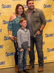 Fans get their picture taken with Josh Gracin before the start of Cat Country 98.7's third annual Miracle on Palafox concert at the Saenger Theatre in Pensacola, Florida, in November 2017. The fundraiser provided gifts for needy children at Christmas. (Photo: JodyLink/online@pnj.com)