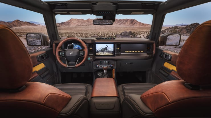 The 2021 Ford Bronco interior includes an available 12-inch infotainment system, optional leather trim seating, console - mounted transmission shifter/selector and G.O.A.T. Modes control knob. Ford