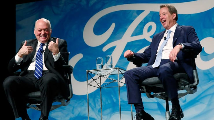 Jim Hackett, incoming chief executive officer of Ford Motor Co., left, and Bill Ford, executive chairman of Ford Motor Co., laugh during an event at the company's headquarters in Dearborn, Michigan, on Tuesday, May 22, 2017. Jeff Kowalsky | Bloomberg | Getty Images
