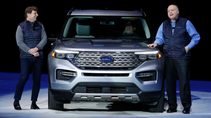 Jim Hackett, president and chief executive officer of Ford Motor Co., right, speaks as Jim Farley, president of global markets, stands next to a 2020 Ford Motor Co. Explorer sport utility vehicle (SUV) during a reveal event in Detroit, Michigan, U.S., on Wednesday, Jan. 9, 2019. Jeff Kowalsky | Bloomberg | Getty Images