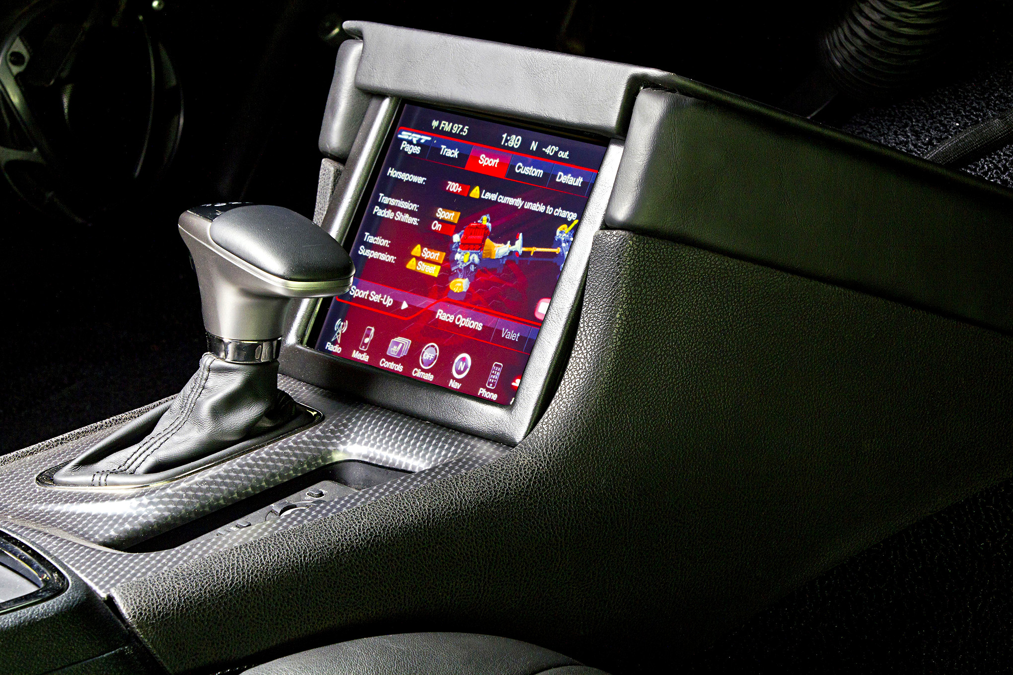 While not all factory parameters are functioning, Larry did retained the touchscreen LCD from the Hellcat which allows selection of performance modes.