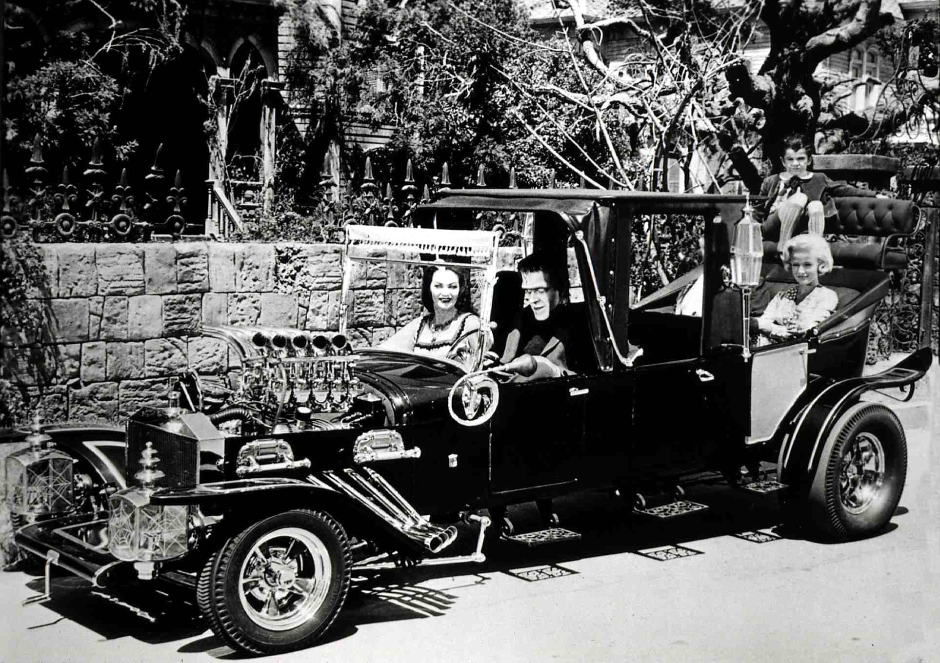 The Munsters Koach with (left to right) Yvonne de Carlo (Lily), Fred Gwynne (Herman), Butch Patrick (Eddie), and Beverly Owen (the original Marilyn) in 1964. FilmPublicityArchive/United Archives via Getty Images
