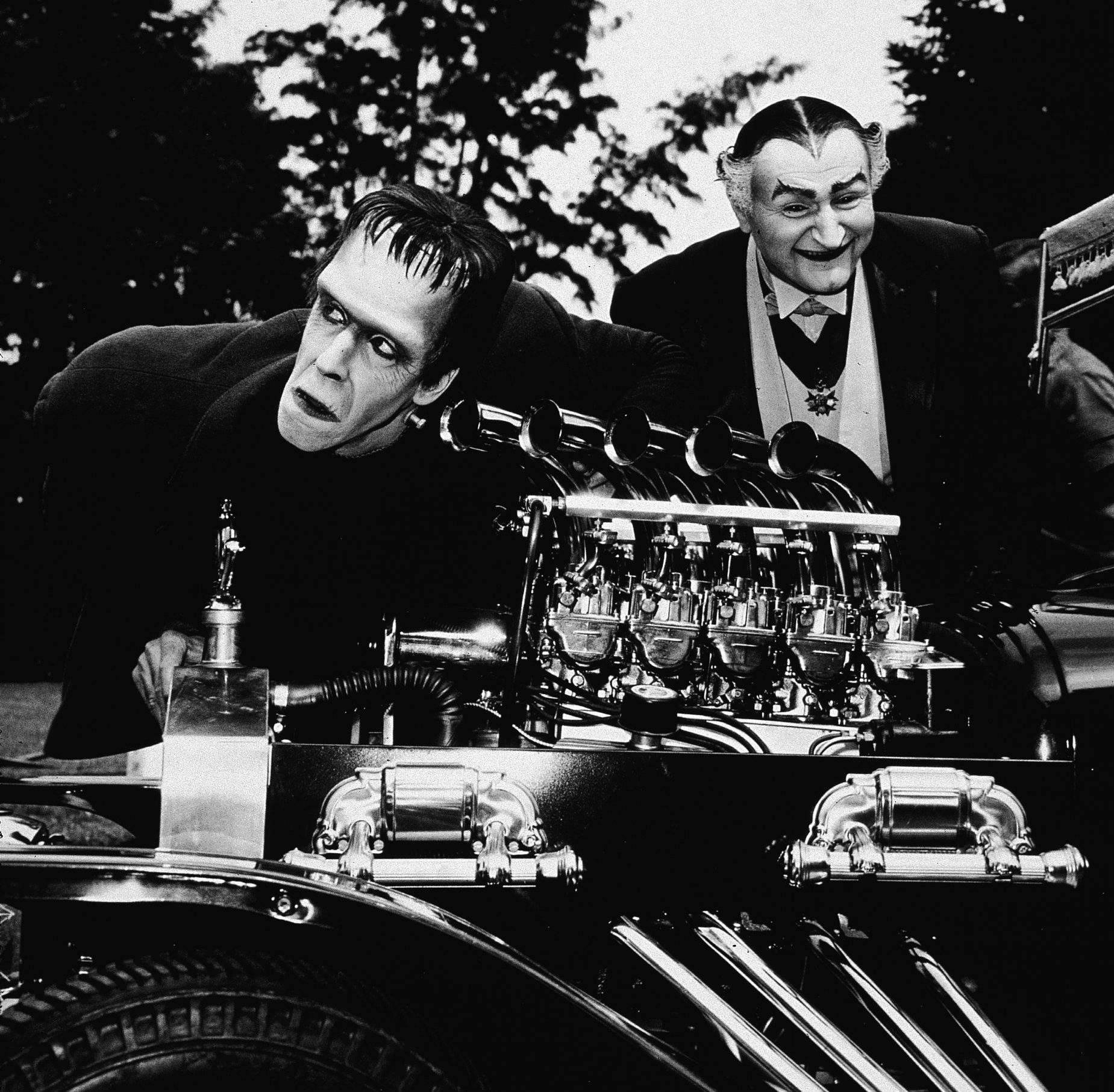 Actors Fred Gwynne (left) and Al Lewis pose with the Munsters Koach, circa 1964. Hulton Archive/Getty Images