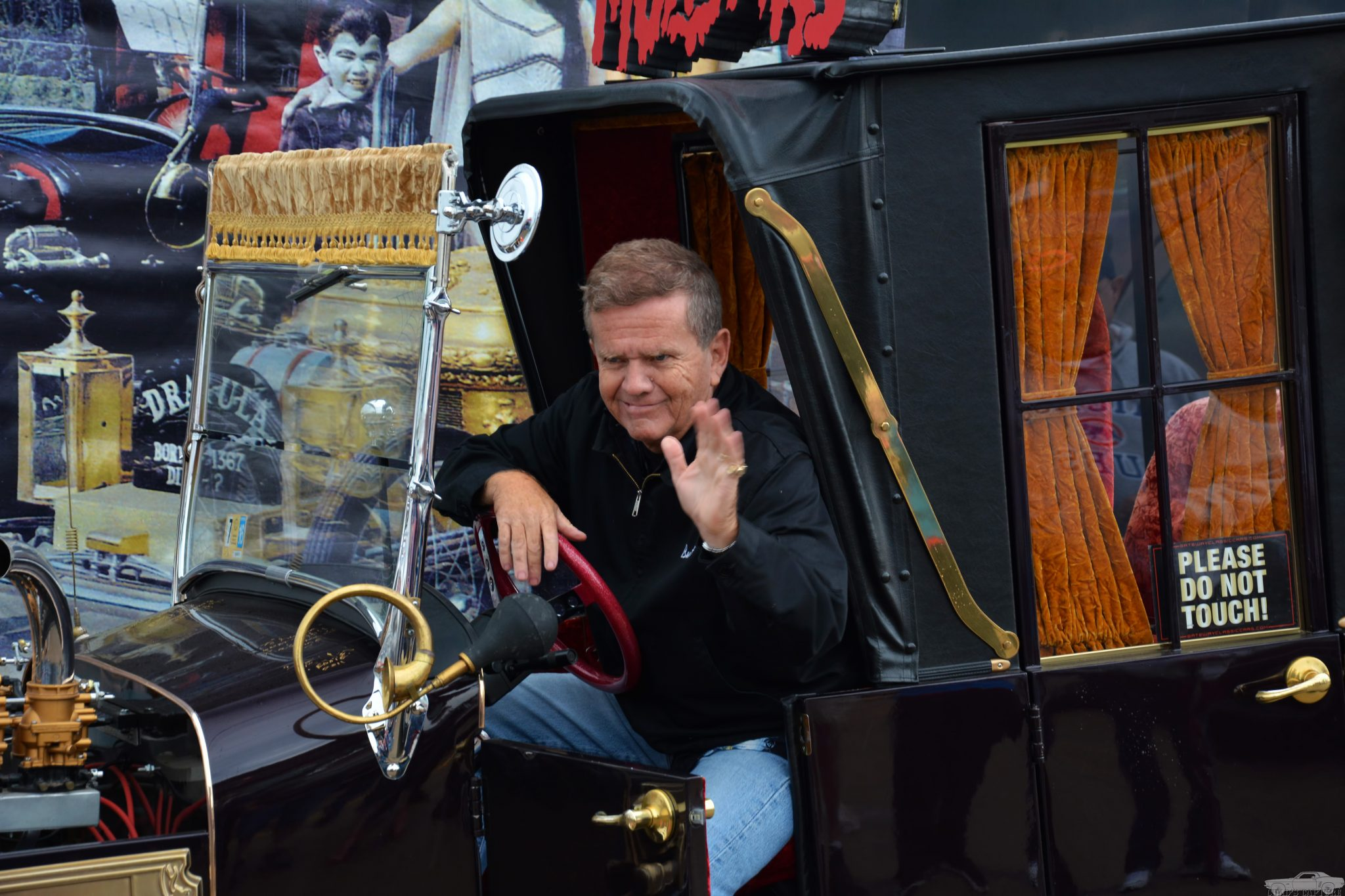 Butch Patrick, also known as Eddie Munster, waves from the Munsters Koach. Flickr/Chad Horwedel