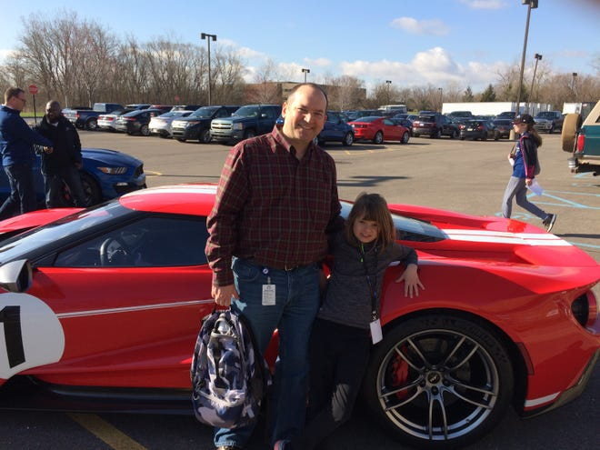 Jack Cooper with his daughter, Allison Cooper, outside his Ford office in Allen Park in 2018. The architecture engineer played a key role in developing the 2021 Ford F-150 Raptor. Jack Cooper