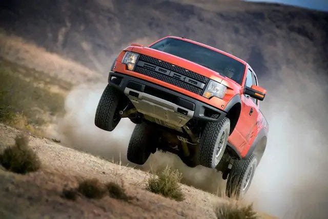 This Molten Orange first generation 2010 Ford F-150 Raptor is seen here in November 2008, possibly in Anza Borrego, California. The vehicle went on sale in 2009. Ford Motor Co.