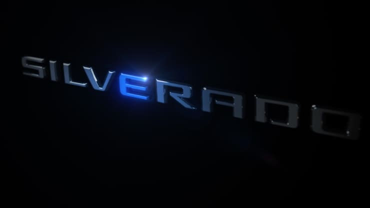 """General Motors plans to produce an all-electric Chevrolet Silverado pickup at its new flagship assembly plant for EVs that's under construction in Detroit. The automaker released this teaser image of the vehicle's name with a """"E"""" highlighted in blue. GM"""