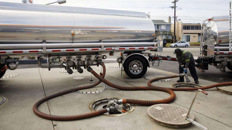 A worker disconnects hoses after delivering gasoline to a station in Redondo Beach, California. A shortage of tanker truck drivers could cause some stations to run out of gas this summer, according to industry experts.