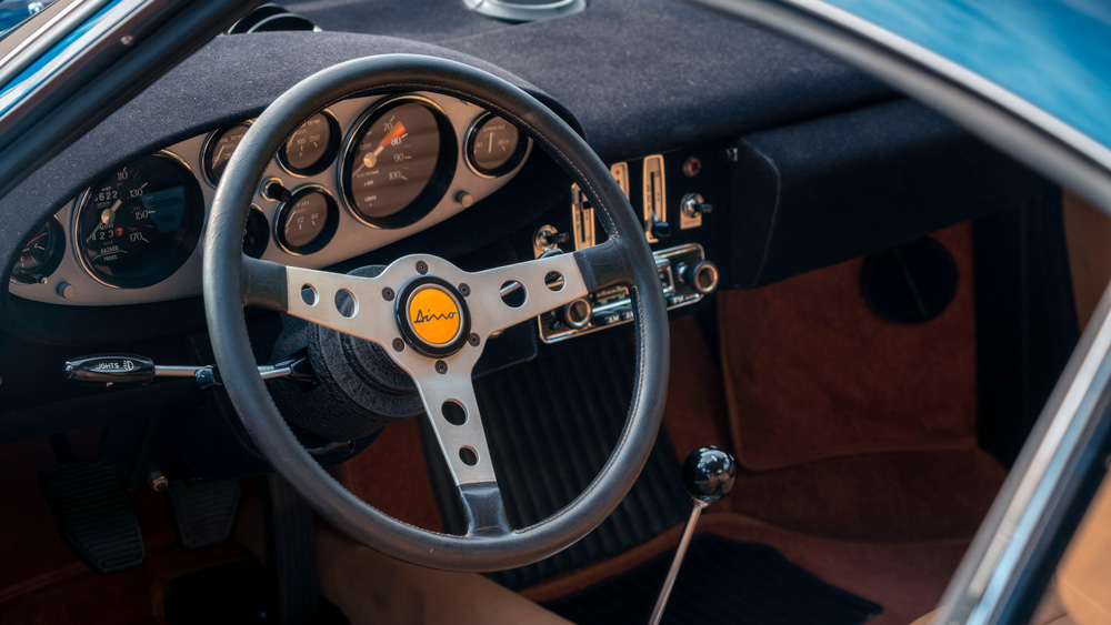This example of the Dino 246 GT features a beige leather interior and a 1970's-era dash.  Photo by WayUp Media.