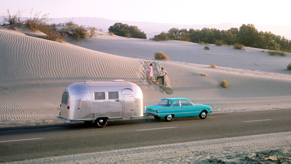 """A couple head off the beaten path with their Airstream in tow around the middle of last century.  Photo: Courtesy of """"Alumination"""""""