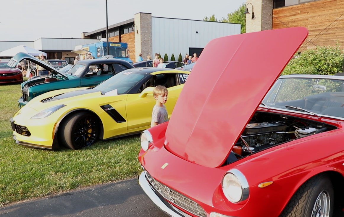 Young boy looking at classic cars at Throttlestop